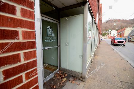 ADVANCE FOR USE AT 3:01 A.M. EST AND THEREAFTER-This Thursday, Nov. 29, 2018 photo shows a recently-closed crisis and detox center in downtown Logan, W.Va. The drug overdose death rate for all Americans today is where West Virginia's rate was 10 years ago. The nation's suicide rate is where West Virginia's was nearly 20 years ago