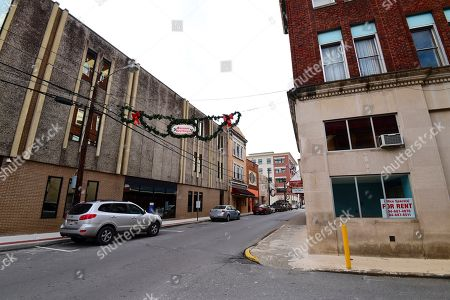 """3:01 A.M. EST AND THEREAFTER-Many of the empty storefronts in downtown Logan, W.Va., display """"for rent"""" or """"for sale"""" signs in their windows, Thursday, Nov. 29, 2018. Obesity was common in West Virginia before it became widespread in the rest of the country. And life expectancy started tumbling in the Mountain State before it began falling across the U.S"""