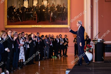Former US Secretary of State John F. Kerry (R) waves to the audience after speaking during an award ceremony for the Otto Hahn Peace Medal 2018 at the Rotes Rathaus in Berlin, Germany, 14 December 2018. Kerry receives the Gold Medal which is named after the German nuclear chemist and 1944 Nobel Laureate Otto Hahn, who is an honorary citizen of Berlin.