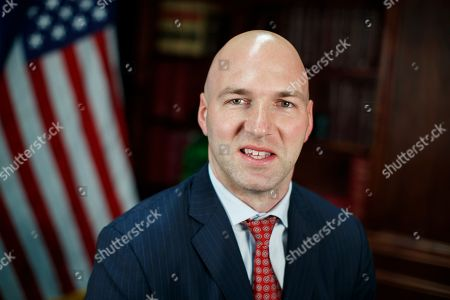 Rep.-elect Anthony Gonzalez, R-Ohio is photographed in a studio at the National Republican Congressional Committee offices in Washington. This year's midterm election is sending a record 43 Latinos to Congress