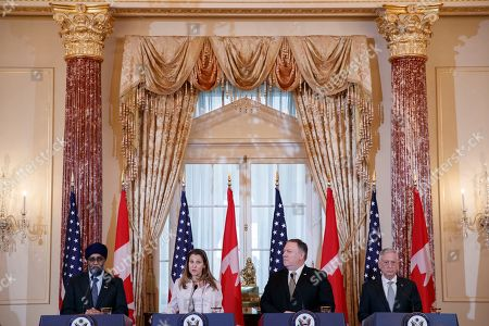 US Secretary of State Mike Pompeo (2-R), Secretary of Defense James Mattis (R), Canadian Foreign Minister Chrystia Freeland (2-L) and Canadian Defense Minister Harjit Sajjan (L) participate in a joint press conference during the US-Canada 2+2 Ministerial at the State Department in Washington, DC, USA, 14 December 2018. US Secretary of State Mike Pompeo and Secretary of Defense James Mattis host the US-Canada 2+2 Ministerial with Canadian Foreign Minister Chrystia Freeland, and Canadian Defense Minister Harjit Sajjan at the Department of State.