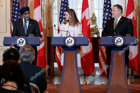 US Secretary of State Mike Pompeo (R), Canadian Foreign Minister Chrystia Freeland (C) and Canadian Defense Minister Harjit Sajjan (L) participate in a joint press conference during the US-Canada 2+2 Ministerial at the State Department in Washington, DC, USA, 14 December 2018. US Secretary of State Mike Pompeo and Secretary of Defense James Mattis host the US-Canada 2+2 Ministerial with Canadian Foreign Minister Chrystia Freeland, and Canadian Defense Minister Harjit Sajjan at the Department of State.