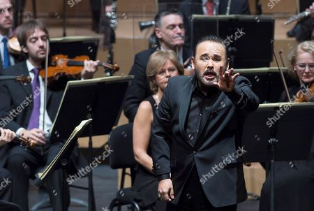 Mexican tenor Javier Camarena (C) performs with Navarra Symphonic Orhestra directed by Ivan Lopez Reynoso during a concert in memory of Spanish soprano Montserrat Caballe in Navarra, Pamplona, Spain, 14 December 2018.