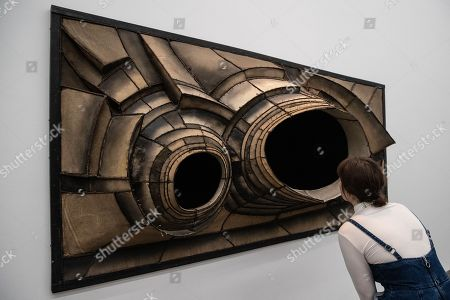 A woman looks at the artwork 'untittled' by US sculptor Lee Bontecou during the exhibition 'Local Histories' at the Hamburger Bahnhof Museum in Berlin, Germany, 14 December 2018. The exhibition of artworks from the Friedrich Christian Flick Collection will be open to public until 29 September 2019.