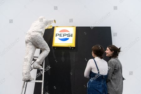 People look at the artwork 'Man Installing Pepsi-Sign' by US sculptor George Segal during the exhibition 'Local Histories' at the Hamburger Bahnhof Museum in Berlin, Germany, 14 December 2018. The exhibition of artworks from the Friedrich Christian Flick Collection will be open to public until 29 September 2019.