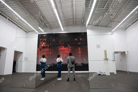People look at the artwork 'Science Fiction / Hier und jetzt zufrieden sein' (lit. Science Fiction / Here and now satisfied' by German artists Wolfgang Tillmans and Isa Genzken during the exhibition 'Local Histories' at the Hamburger Bahnhof Museum in Berlin, Germany, 14 December 2018. The exhibition of artworks from the Friedrich Christian Flick Collection will be open to public until 29 September 2019.