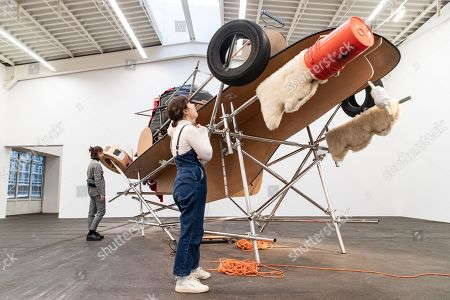 People look at the artwork 'Fucking Ricabia Cars with Ejection Seat' by US artist Jason Rhoades during the exhibition 'Local Histories' at the Hamburger Bahnhof Museum in Berlin, Germany, 14 December 2018. The exhibition of artworks from the Friedrich Christian Flick Collection will be open to public until 29 September 2019.