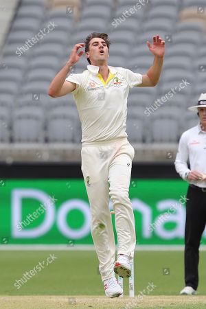 Australia's Pat Cummins reacts after a near miss during play in the second cricket test between Australia and India in Perth, Australia