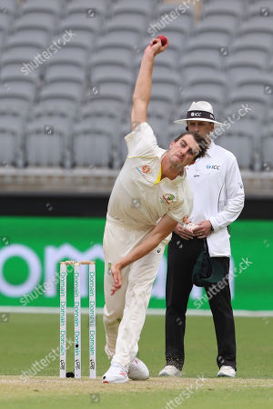 Australia's Pat Cummins bowls during play in the second cricket test between Australia and India in Perth, Australia