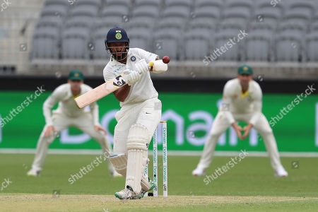 India's Cheteshwar Pujara bats during play in the second cricket test between Australia and India in Perth, Australia