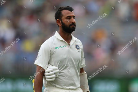 India's Cheteshwar Pujara walks off after being dismissed during play in the second cricket test between Australia and India in Perth, Australia