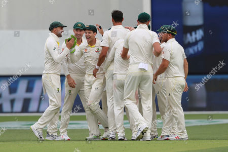 Australian players celebrate the dismissal of India's Cheteshwar Pujara during play in the second cricket test between Australia and India in Perth, Australia