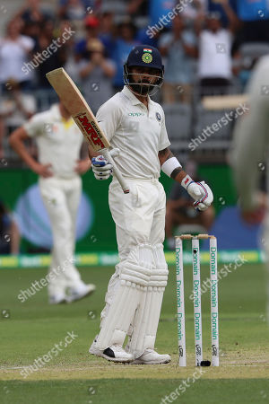 India's Virat Kohli celebrates reaching 50 runs during play in the second cricket test between Australia and India in Perth, Australia