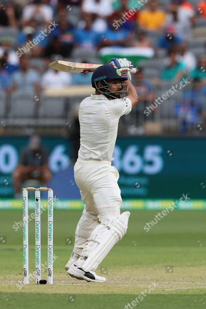 India's Virat Kohli bats during play in the second cricket test between Australia and India in Perth, Australia