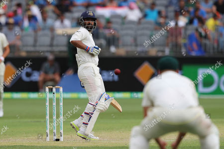 India's Ajinkya Rahane watches as the ball heads towards a fielder during play in the second cricket test between Australia and India in Perth, Australia