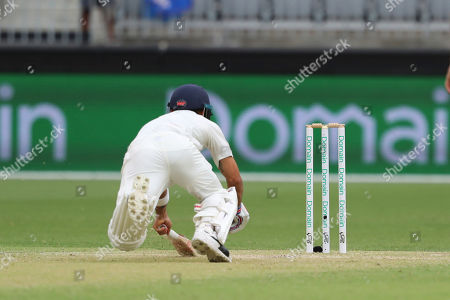 Virat Kohli dives to make his crease and avoid being run out during play in the second cricket test between Australia and India in Perth, Australia