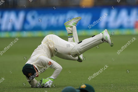 Australia's wicketkeeper Tim Paine dives to stop a stop the ball during play in the second cricket test between Australia and India in Perth, Australia