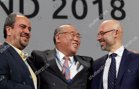 Majid Shafiepour Motlagh,Xie Zhenhua,Michal Kurtyka. Iran's head of delegation Majid Shafiepour Motlagh, China's head of delegation Xie Zhenhua and COP24 President Michal Kurtyka smile after adopting the final agreement during a closing session of the COP24 in Katowice, Poland