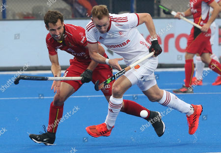 Britain's David Ames (R) in action during the men's Field Hockey World Cup semifinal match between Britain and Belgium at the Kalinga Stadium in Bhubaneswar, India, 15 December 2018.