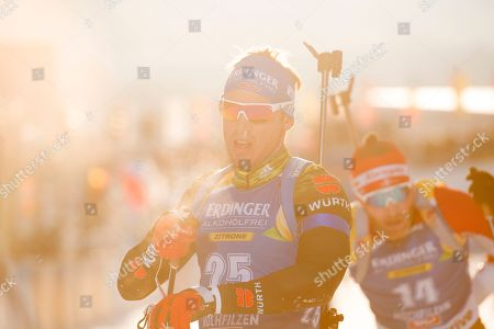 Simon Schempp of Germany (L) and Simon Eder of Austria (R) are seen in the finish area after the men's 12.5 km pursuit race at the IBU Biathlon World Cup in Hochfilzen, Austria, 15  December 2018.