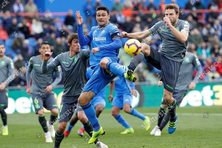 Getafe's FC forward Jorge Molina (C) vies for the ball with Real Sociedad's midfielder Asier Illarramendi (R) during the Primera Division Liga match between Getafe FC and Real Sociedad held at Alfonso Perez Coliseum in Getafe, Spain, 15 December 2018.