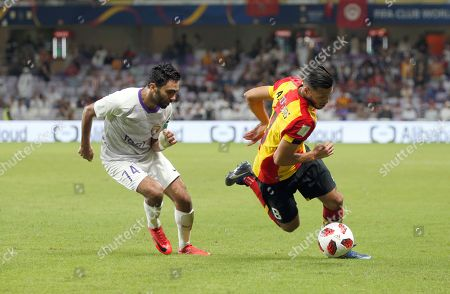 Anice Badri (R) of ES Tunis in action against Hussein Elshahat of Al Ain FC during the FIFA Club World Cup 2018 second round match between Al Ain FC and ES Tunis in Al Ain, United Arab Emirates, 15 December 2018.