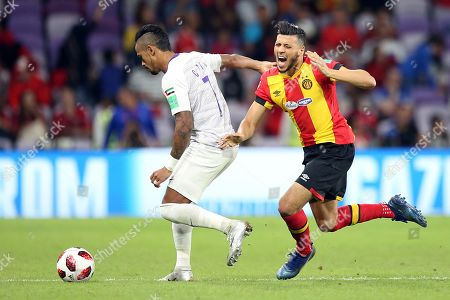 Anice Badri (R) of ES Tunis in action against Caio (L) of Al Ain FC during the FIFA Club World Cup 2018 match between ES Tunis and Al Ain FC in Al Ain, United Arab Emirates, 15 December 2018.