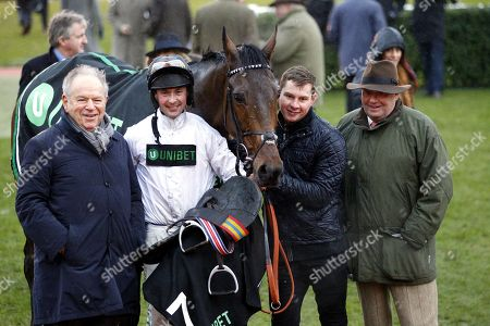 Stock Photo of Michael Buckley [left] with jockey Nico De Boinville and trainer Nicky Henderson after Brain Power had won the Unibet International Hurdle at Cheltenham.