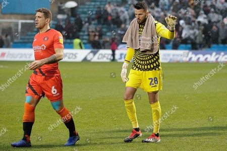 Wycombe Wanderers defender Adam El-Abd (6) and Wycombe Wanderers goalkeeper Stephen Henderson (28) during the EFL Sky Bet League 1 match between Gillingham and Wycombe Wanderers at the MEMS Priestfield Stadium, Gillingham