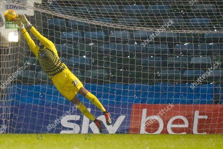 Wycombe Wanderers goalkeeper Stephen Henderson (28) makes a save in front of Sky Bet advertising during the EFL Sky Bet League 1 match between Gillingham and Wycombe Wanderers at the MEMS Priestfield Stadium, Gillingham