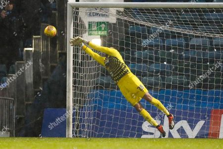 Wycombe Wanderers goalkeeper Stephen Henderson (28) makes a diving save during the EFL Sky Bet League 1 match between Gillingham and Wycombe Wanderers at the MEMS Priestfield Stadium, Gillingham
