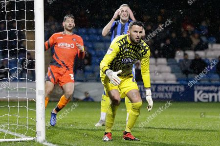 Wycombe Wanderers goalkeeper Stephen Henderson (28), Wycombe Wanderers defender Joe Jacobson, Gillingham striker Tom Eaves (9) holds his face, during the EFL Sky Bet League 1 match between Gillingham and Wycombe Wanderers at the MEMS Priestfield Stadium, Gillingham
