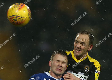 Notts County's David Vaughan wins an aerial duel with Tranmere Rovers James Harris