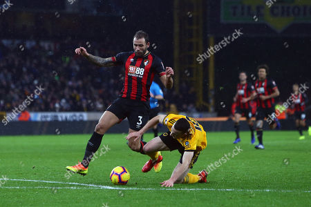 Bournemouth's Steve Cook takes down Wolves' Diogo Jota on the edge of the penalty area