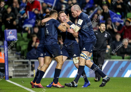 Stock Image of Leinster vs Bath. Leinster's Rory O?Loughlin celebrates scoring a try with Adam Byrne, Luke McGrath and Devin Toner