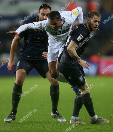 Kyle Naughton of Swansea City is tackled by Ashley Baker of Sheffield Wednesday.