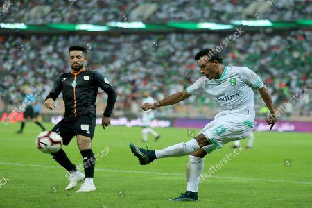 Al-Shabab player Hattan Bahebri (L) in action for the ball with Al-Ahli player Mohamed Abdel Shafy (R) during the Saudi Professional League soccer match between Al-Ahli and Al-Shabab at King Abdullah Al Jawhara International Stadium, Jeddah, Saudi Arabia, 15 December 2018.