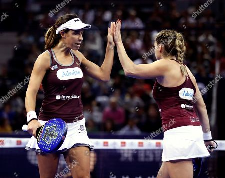 Marta Marrero (L) and Alejandra Salazar (R) celebrate after defeating Marta Ortega and Ariana Sanchez during the women's semi final match at the Estrella Damm Master Final of the World Padel Tour tournament, in Madrid, Spain, 15 December 2018.