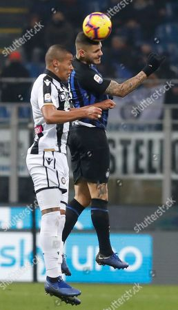Inter Milan's Mauro Icardi, right, and Udinese's William Troost Ekong, jump for the ball during an Italian Serie A soccer match between Inter Milan and Udinese, at the San Siro stadium in Milan, Italy
