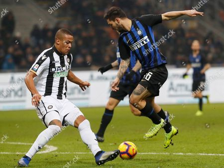 Inter Milan's Matteo Politano,right, and Udinese's William Troost Ekong, vie for the ball during an Italian Serie A soccer match between Inter Milan and Udinese, at the San Siro stadium in Milan, Italy