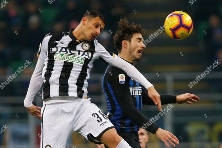 Stock Photo of Inter Milan's Sime Vrsaljko, right, and Udinese's Rolando Mandragoravie for the ball during an Italian Serie A soccer match between Inter Milan and Udinese, at the San Siro stadium in Milan, Italy