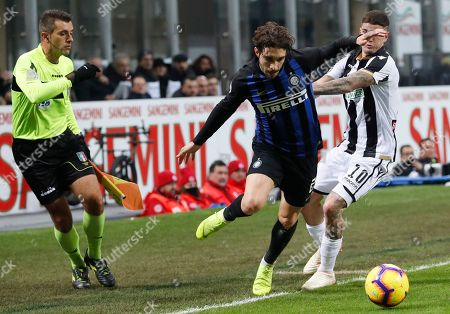 Inter Milan's Sime Vrsaljko and Udinese's Rodrigo De Paul, right, vie for the ball during an Italian Serie A soccer match between Inter Milan and Udinese, at the San Siro stadium in Milan, Italy