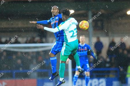 Calvin Andrew wins the ball from Ashley Smith-Brown during the EFL Sky Bet League 1 match between Rochdale and Plymouth Argyle at Spotland, Rochdale
