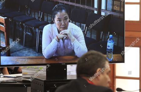 Stock Image of The opposition political leader Keiko Fujimori (L), through a video call from the penitentiary in which she is serving a preventive detention, and the prosecutor Rafael Vela (R), the fiscal coordinator of the Lava Jato Special Team, participate in a hearing, in the second appeals chamber, in Lima, Peru, 15 December 2018. The Criminal Court of Appeals of the Peruvian Judicial Branch today began the hearing in which it will evaluate the appeal filed by the opposition leader Keiko Fujimori to revoke the preventive prison sentence against her, for the alleged irregular contributions in her 2011 presidential campaign.