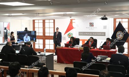 The opposition political leader Keiko Fujimori (L), through a video call from the penitentiary in which she is serving a preventive detention, participates in a hearing, in the second appeals chamber, in Lima, Peru, 15 December 2018. The Criminal Court of Appeals of the Peruvian Judicial Branch today began the hearing in which it will evaluate the appeal filed by the opposition leader Keiko Fujimori to revoke the preventive prison sentence against her, for the alleged irregular contributions in her 2011 presidential campaign.