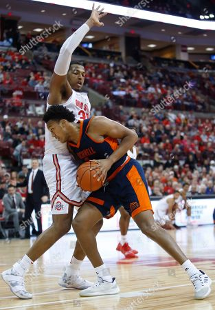 Bucknell's Paul Newman, right, posts up against Ohio State's Kaleb Wesson, left, during the first half of an NCAA college basketball game, in Columbus, Ohio
