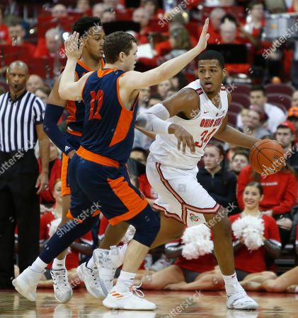 Ohio State's Kaleb Wesson, right, posts up against Bucknell's Paul Newman, left, and John Meeks during the first half of an NCAA college basketball game, in Columbus, Ohio