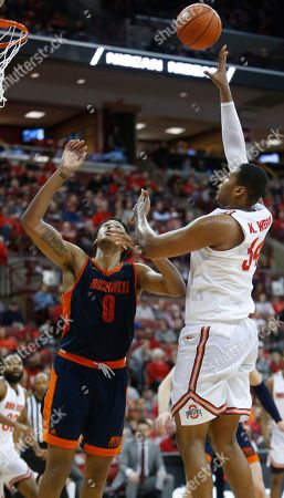 Ohio State's Kaleb Wesson, right, shoots over Bucknell's Paul Newman during the second half of an NCAA college basketball game, in Columbus, Ohio. Ohio State beat Bucknell 73-71