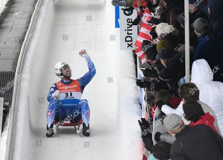 Chris Mazdzer, of the United States, celebrates with fans after competing in the men's luge World Cup event, in Lake Placid, N.Y