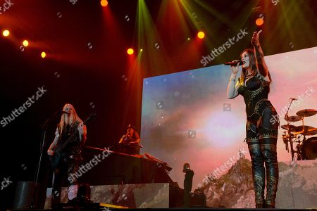 Lead singer Floor Jansen (R), keyboardist Tuomas Holopainen and bassist / singer Marco Hietala of the Finnish symphonic metal band Nightwish perform on stage during their Decades: World Tour 2018 concert